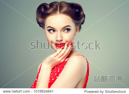Pin up girl vintage. Wow expressions emotion! Beautiful woman pinup style portrait in retro dress and makeup  manicure nails hands  red lipstick and polka dot dress  surprised face.