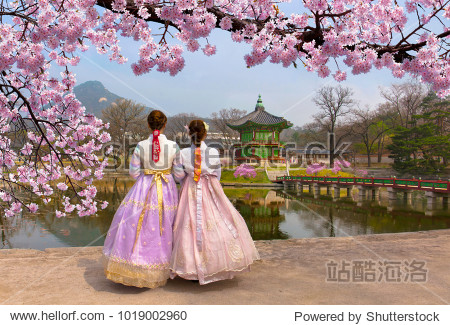 Cherry Blossom in spring with Korean national dress at Gyeongbokgung Palace  Seoul South Korea.