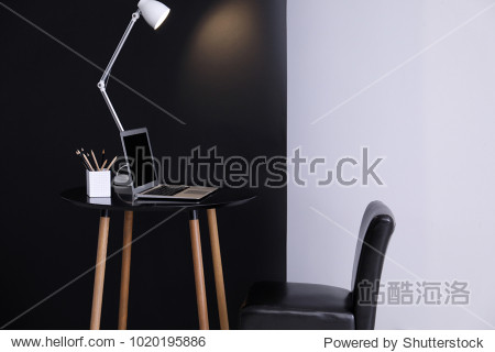 Living room interior with comfortable workplace near wall