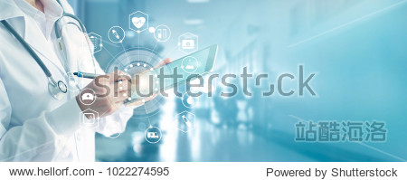 Medicine doctor and stethoscope touching icon medical network connection with modern interface on digital tablet in hospital background. Medical technology network concept