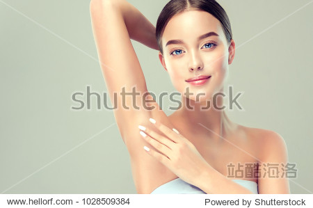 Young woman holding her arms up and showing underarms  armpit smooth clear skin .Girl showing clean armpit .Beauty portrait.Epilation and depilation of hair .