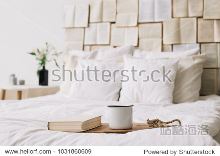 Spring still life. Breakfast in bed. White bedroom. Sweet home. Books  flowers and coffee cup. flat lay