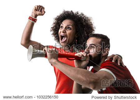 Young couple fan celebrating on red uniform