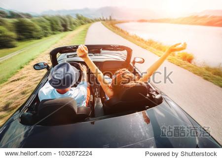 Couple in love ride in cabriolet car