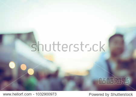Vintage tone blurred defocused day of walking street festival in