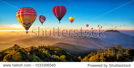 Colorful hot air balloons flying over mountain at Dot Inthanon in Chiang Mai  Thailand.