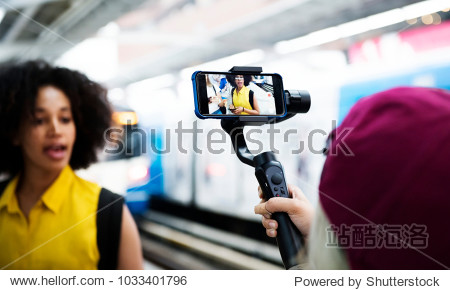 Young adult woman traveling and blogging social media concept