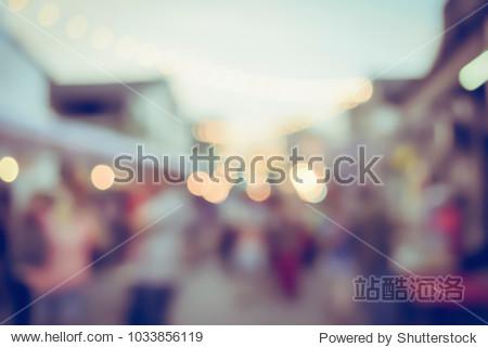 Vintage tone blurred defocused day of walking street festival