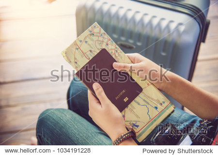 People holding passports  map for travel with luggage for the trip