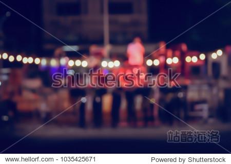 Vintage tone blurred defocused night of walking street festival concert in thailand bokeh background