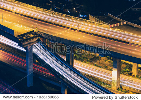 Light trails on express highway at night  long exposure abstract urban background