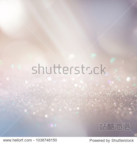 Glitter background in pastel delicate beige and pearl tones  de-focused  free space.