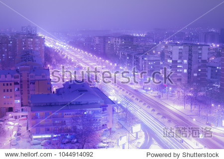 An aesthetic view of a snow covered city in long exposure.