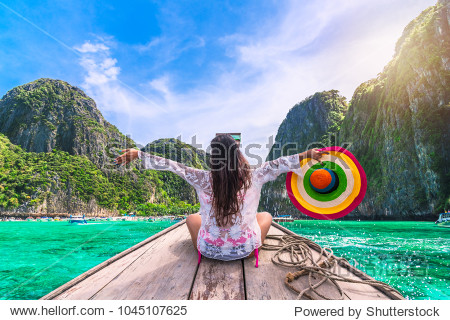 Happy traveler woman in summer dress joy fun relaxing on boat  Maya beach  Phi Phi island  Tourism Phuket  Krabi  Travel Thailand  Beautiful destination Asia  Summer holiday outdoor vacation trip