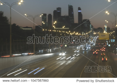 Busy.  Panorama of the traffic on the streets of Moscow. Crimean Bridge and International business centre. Long exposure night Highway Traffic.