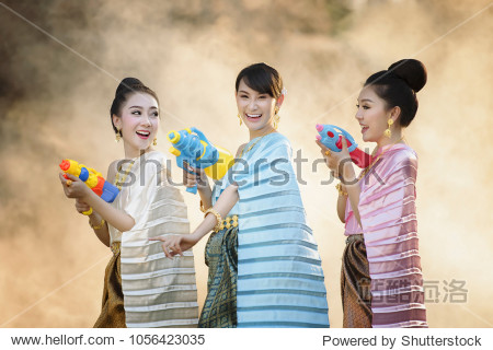 Thai girls and laos girls splashing water during Songkran festival Water blessing ceremony of adults Buddha statue water ceremony in songkran festival Thailand traditional.