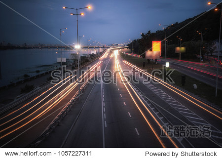 Speed car traffic. Light trails on highway at night  long exposure abstract urban background