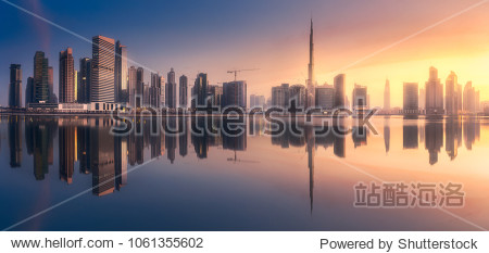 Mystical panoramic view of Dubai Business bay with purple sunrise  UAE