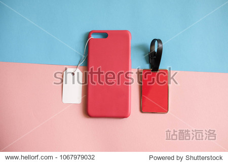 Template mock up : Red color  phone case with price tag and red name tag or keychainon pink and blue background