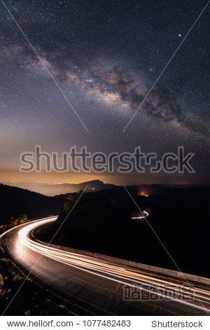 Milky way over the road S-curve  Night sky astrophotography.