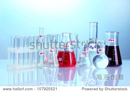 Test-tubes with various acids on blue background