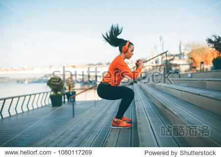 Fitness woman jumping outdoor in urban enviroment