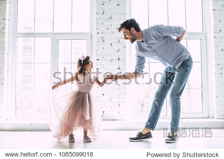 I love you  dad! Handsome young man is dancing at home with his little cute girl. Happy Father's Day!
