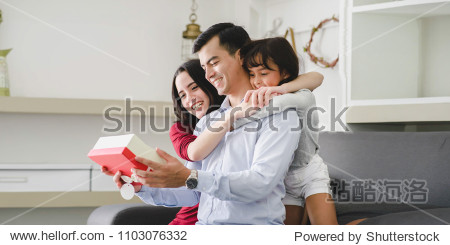Father's day. Happy family  Activity of family at home .Daughter have a gift for daddy.  Family  Gift  Christmas  Holidays Concept.