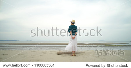 Asian woman standing at the beach