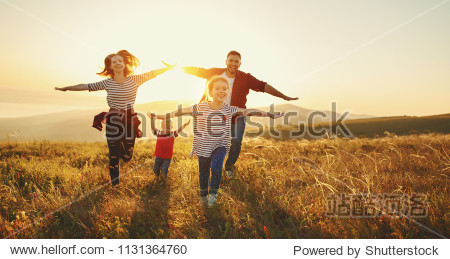 Happy family: mother  father  children son and  daughter on nature  on sunset
