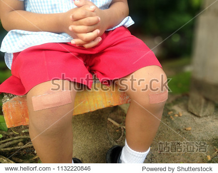 Plasters on knees  Children knee abrasion.