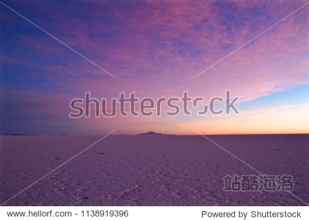 Pink sunrise over the Salt lake of Salar de Uyuni  the biggest salt lake in the world and one of the Landmark of Bolivia