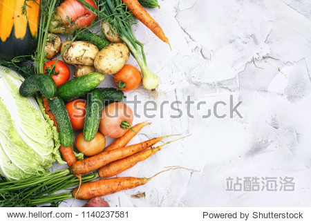 Сomposition of fresh vegetables on textured light marble table. Assortment of vegetables  potatoes  cucumbers  carrots  onions  cabbage  zucchini  tomatoes. Concept of healthy eating  copy space.