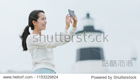 Woman use of cellphone to take photo at outdoor