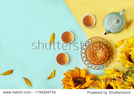 Chinese Mid Autumn Festival Moon cake and tea on color background with copy