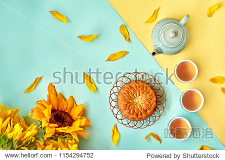 Chinese Mid Autumn Festival Moon cake and tea on color background