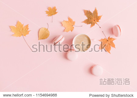 Autumn  elegant composition. Cup of coffee and dry leaves on pastel pink background. Flat lay  top view  copy space