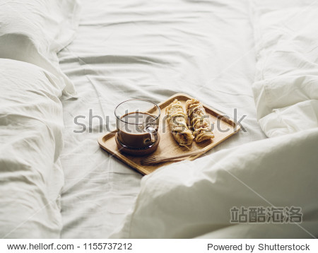 Breakfast set of Thai sweetened roti and hot cocoa served on bed.