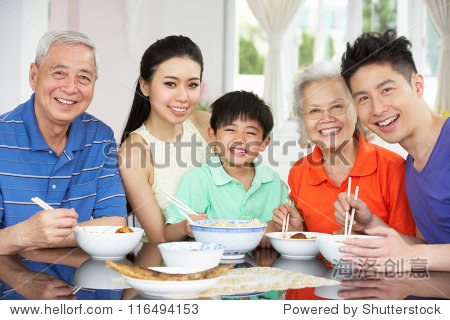 Portrait Of Multi-Generation Chinese Family Eating Meal Together