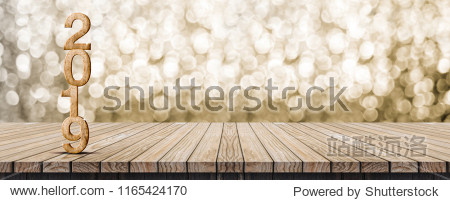 2019 happy new year wood number (3d rendering) on wood table with sparkling gold bokeh wall leave space for banner display or montage of design or content