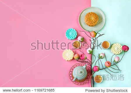 Traditional Moon cake with teapot setting on colorful background. Moon cake festival with copy