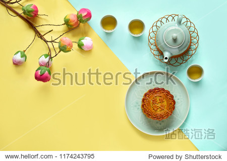 Moon cake and tea for mid autumn festival with text space.Moon cake Chinese text translation: Single yolk salty.