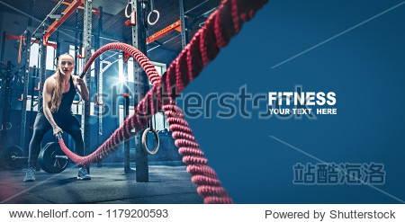 Woman with battle rope battle ropes exercise in the fitness gym. gym  sport  rope  training  athlete  workout  exercises concept