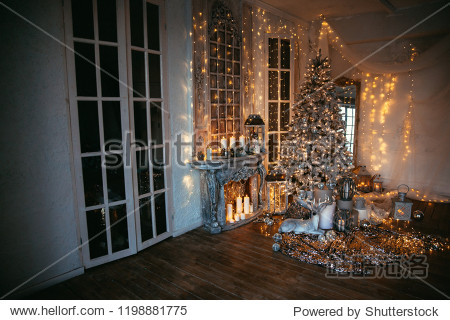 warm and cozy evening in Christmas room interior design Xmas tree decorated by lights presents gifts toys  deer candles  lanterns  garland lighting indoors fireplace.holiday living room.magic New year
