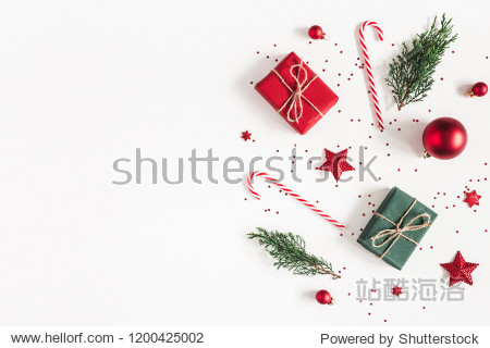 Christmas composition. Gifts  fir tree branches  red decorations on white background. Christmas  winter  new year concept. Flat lay  top view  copy space