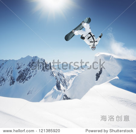 Snowboard Jumping in high mountains
