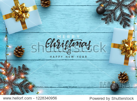 Christmas composition on wooden background. Xmas decoration design  box gift  snowflake color black  gold garland  pine cone. Blue realistic Wood texture. Flat lay  top view.