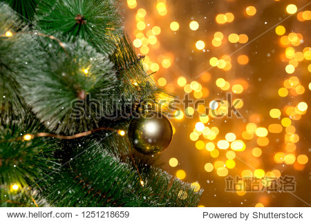 Christmas tree on the background of blurry lights of Christmas garland. Christmas concept.