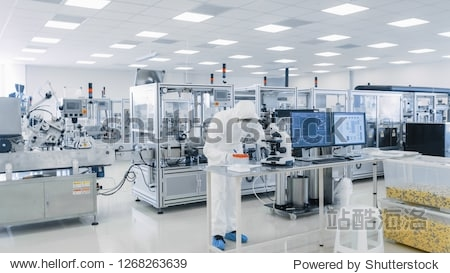 Shot of Sterile Pharmaceutical Manufacturing Laboratory where Scientists in Protective Coverall's Do Research  Quality Control and Work on the Discovery of new Medicine.