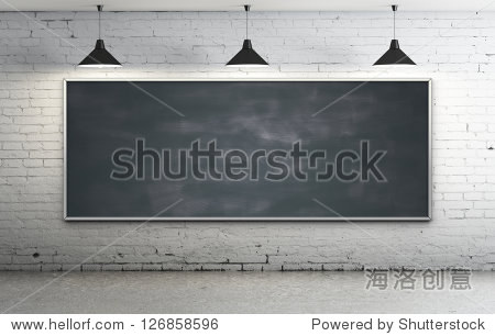 Black blackboard in brick loft